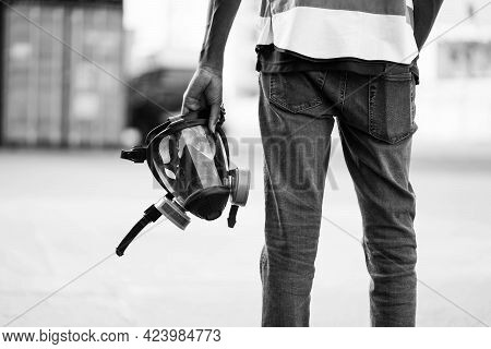 Man Holds A Respirator, Protection Respirator Half Mask For Toxic Gas.the Man Prepare To Wear Protec