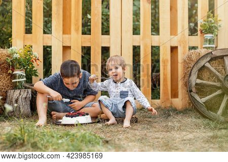 Two Cute Boys Happily Eating Healthy Food Outdoors. Adventure Time. Boys Having Fun Together In Fore