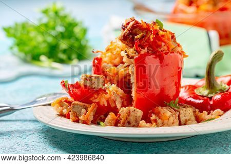 Stuffed Peppers With Tofu, Rice And Vegetables Are Served In A Plate With Tomato Sauce. Concept Is T