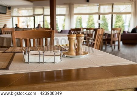 Part Of Restaurant Table Setting Salt, Pepper, Toothpicks And Paper Napkins In The Box On Table.whit