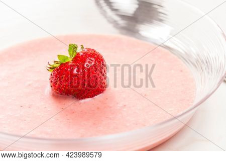 still life of summer strawberry soup