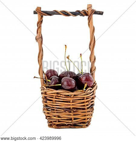 Ripe Sweet Cherries In Wicker Basket Isolated On White Background