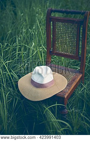 Vintage Sun Hut on an old chair in grass