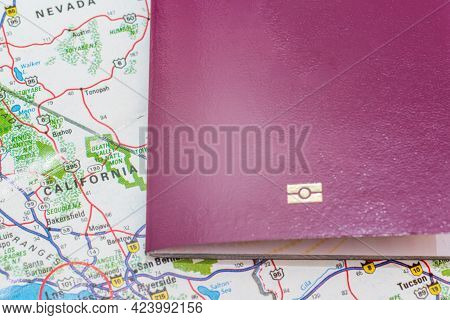 Red Passport Over Map. Focus On The California North American Continent. Emigration, Travel, Destina