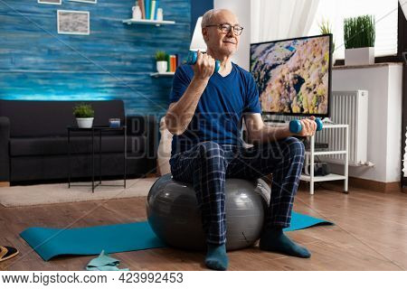Senior Man Holding Dumbbells Doing Arms Exercise Streching Body Muscles Training Muscular Resistance