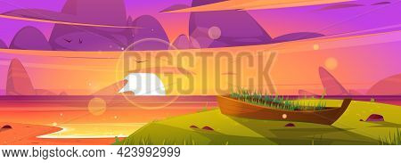 Sunset Beach And Old Wooden Boat With Growing Grass Inside. Ocean Landscape, Purple Clouds In Sky Wi