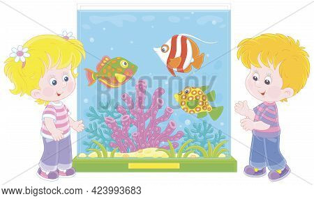 Happy Little Kids Walking Around A Zoological Garden And Watching Funny Tropical Fishes Swimming In