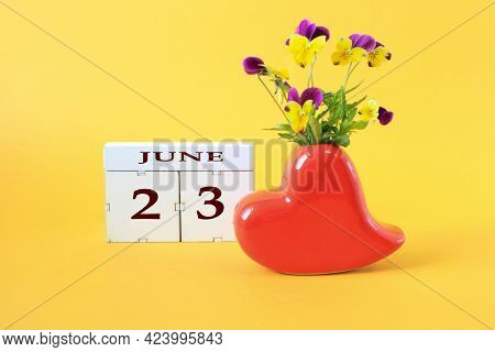 Calendar For June 23 : The Name Of The Month Of June In English, The Number 23, A Vase In The Shape