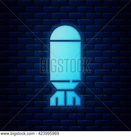 Glowing Neon Aviation Bomb Icon Isolated On Brick Wall Background. Rocket Bomb Flies Down. Vector