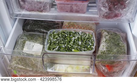 Open Freezer With Frozen Vegetables. Frozen Asparagus, Dill, And Zucchini. Food Storage. Frozen Food