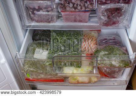 Open Freezer With Frozen Red Cherries And Frozen Vegetables. Food Storage. Deep-frozen Food. Food Su