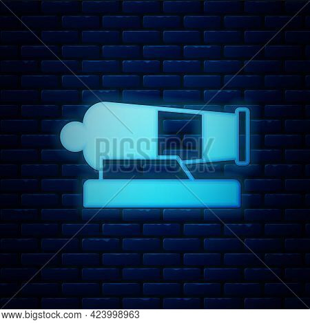 Glowing Neon Cannon Icon Isolated On Brick Wall Background. Vector