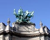 """Quadriga on top of  Le Grand Palais in Paris by Georges Recipon.  Quadriga looking out over the Champs-Elysi??es called """"Immortality outstripping time"""". poster"""