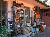 antique shoppe with colectibles displayed outside poster