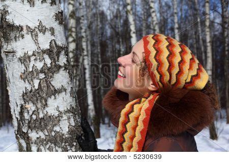 Young Beautiful Woman In Birch Wood In Winter