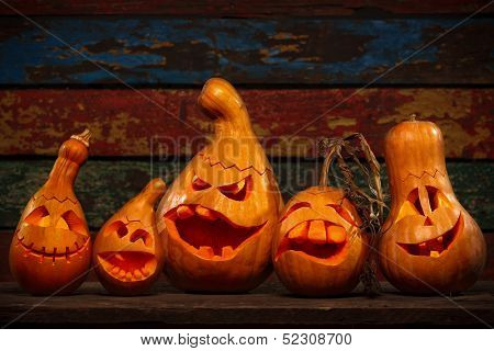 Scary Jack O Lantern Halloween pumpkins in darkness