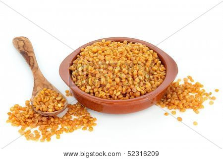 Toor dahl food ingredient in a terracotta bowl and spoon over white background. poster