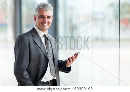 portrait of senior business executive using tablet pc