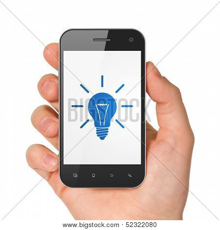 Finance concept: hand holding smartphone with Light Bulb on display. Generic mobile smart phone in hand on White background. poster