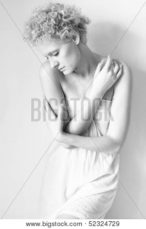 Young scrawny sexy girl, black and white in studio.