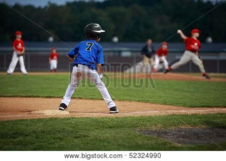 Runner on third base in a baseball game poster