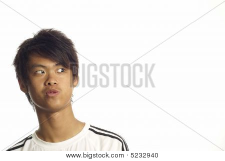 Young asian man looking to side
