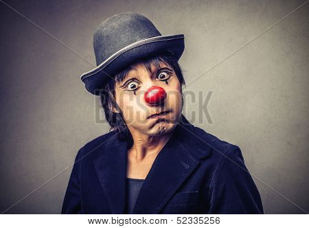 portrait of a funny clown with red nose
