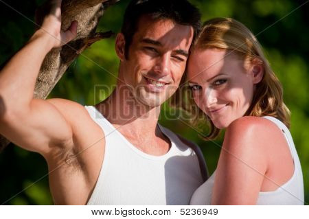 A good-looking couple relaxing on vacation outdoors poster