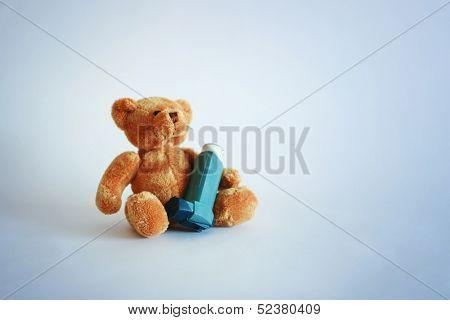 Teddy bear with asthma spray