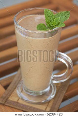 Banana and chocolate milk shake with fresh mint