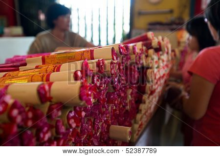 SINGAPORE - SEPTEMBER 19: Devotees buy joss sticks from the counter inside the Shuang Lin Cheng Huang Temple on September 19, 2013 in Singapore. This temple was founded in the 19th century.