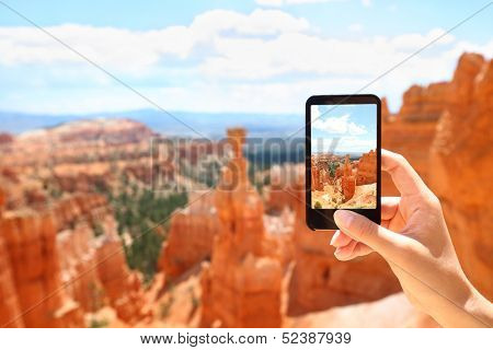 Smartphone camera phone taking photo picture of Bryce Canyon nature. Closeup of mobile phone camera screen photographing beautiful american landscape Bryce Canyon, Utah, USA.