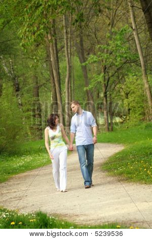 Happy Couple Taking A Walk In A Park
