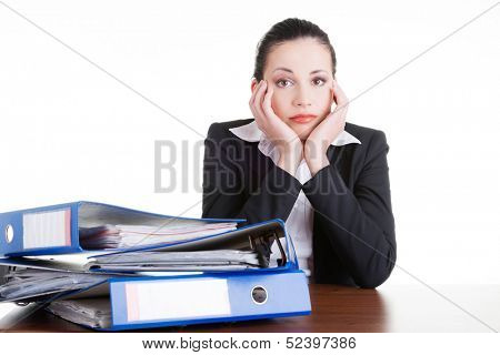 Sad woman with ringbinders sitting at the desk. Tired and exhousted business woman.  poster