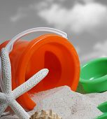 spade and bucket on a beach  poster