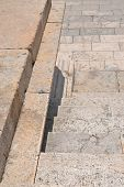 Detail of the white stone historical stairs descending to the square - Roman Empire architecture poster