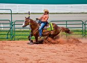 Western horse and rider competing in pole bending and barrel racing competition. poster