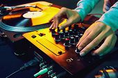 Dj hands on equipment deck and mixer with vinyl record at party poster