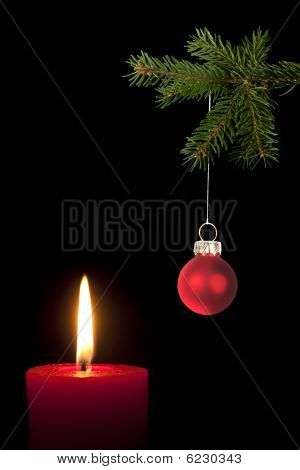 Fir Branch With Christmas Tree Ball And Red Candle