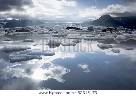 Fjallsarlon Glacier Lake, Sky Reflection In The Water