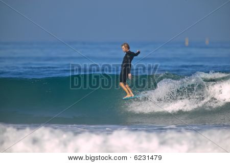Nose Riding Surfer