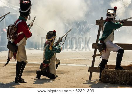 French soldier firing a gun during the Representation of the Battle of Bailen