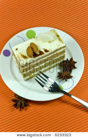 Tasty And Colorful Brown Almond Cake With White Cream Layers.