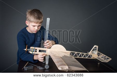Creating the model plane. Measuring thickness. Hobby.