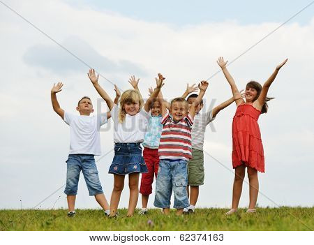 Group of kids on having happy time in nature