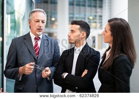 Businessman giving instructions to his colleagues