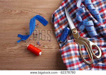 Business suit tailoring, on wooden background