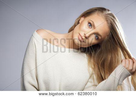 Blond Hair Model Pulling Her Hair