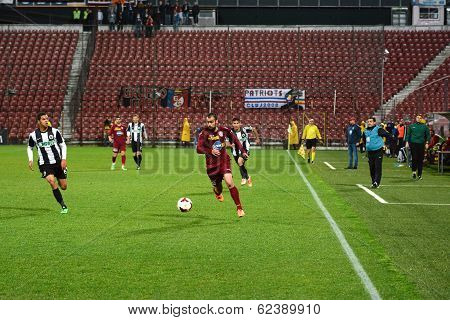 Midfielder Dribling During A Football Match
