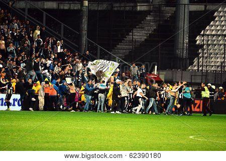 Soccer Hooligans Run On The Soccer Field